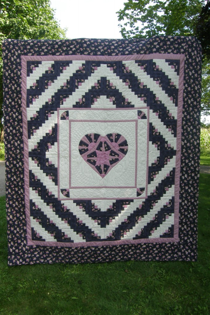 Log Cabin with Heart Quilt (89 x 102 inches) for auction at the 2012 Black Creek Pioneer Village Relief Sale