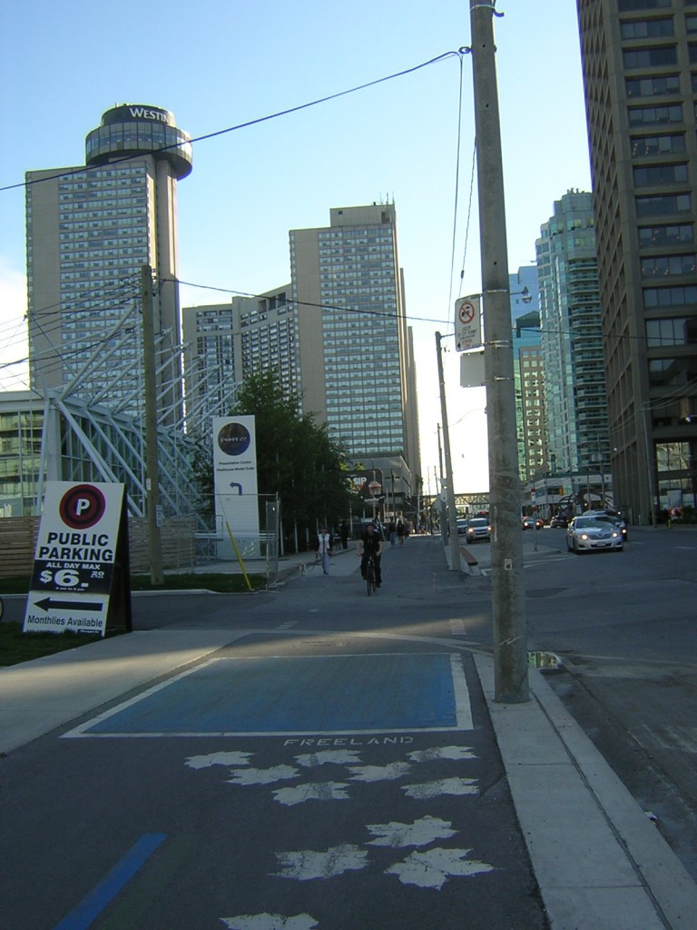 """Blue Intersection Warning on the Martin Goodman Trail on Queens Quay"" image (c) by Mike DeHaan"